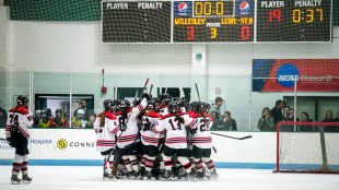 The girls' hockey team celebrates during their game against Leominster on March 4 at their Babson home ice. Photo by Thomas D'Anieri
