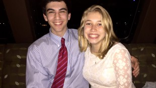 Bradford Editors-in-Chief Zach Miller '17 and Olivia Gieger '17 hide from the rain on Friday's boat cruise.   Photo by Savitri Fouda