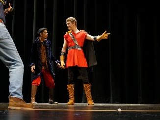 Anand Ghorpadey '17 as Lefou and Scott Johnson '17 as Gaston (left to right) rehearse Gaston's attempts to woo Belle.