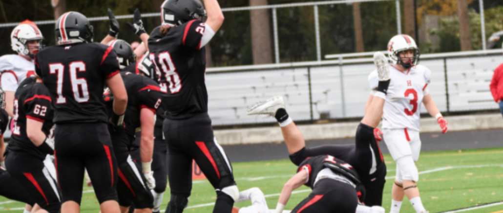 Senior James Mastrianni and teammates celebrate the recovered safety in the second quarter against Hingham. Photo courtesy of James Mastrianni.