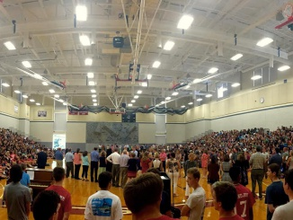 Chisum speaks to the entire student and faculty body at the back to school assembly about the racist Facebook messages from the summer and the high school's need to unify in the face of hate. Photo courtesy of Andrew Tucker.