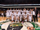 The boys' basketball team poses at center court after their game at TD Garden against Needham. Photo by Wicked Local and Jeff Porter.