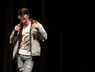 "Blake Foster sings ""Touch the Sky"" by Kanye West. Photo by Kate Waisel."