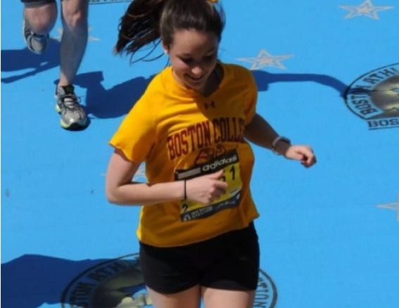 Brennan Mullin finishes the Boston Marathon in 2015. She will run again this year supporting Wellesley ABC.